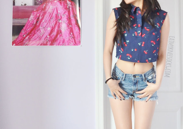 A cute spring/summer outfit featuring Dresslink's FINEJO cropped cherry-print collared shirt, worn with high-waisted ripped Abercrombie shorts.