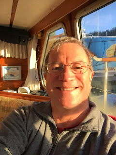 Bill basking in sunlight  in pilothouse