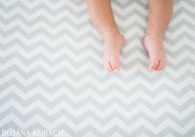 san francsico based photographer bojana korach captures baby feet on a chevron patterned bedding