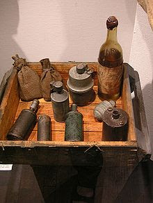 A display of improvised munitions, including a Molotov cocktail, from the Warsaw Uprising, 1944.