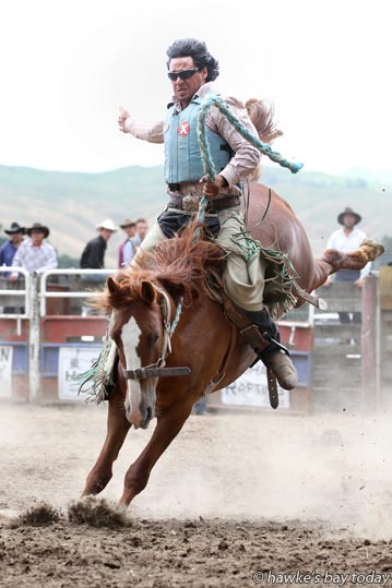 Davey Green competes in the second division saddle bronco event  at the Upper Mohaka Rodeo at Upper Mohaka Domain photograph