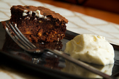A photograph of a Brownie and cream