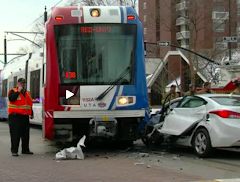 SLC's TRAX was derailed when car ran red light on 3/7/12