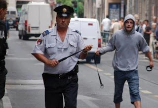 funniest picture: protester prepares to fight with a police officer
