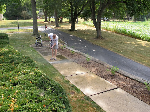 Brian Power-Washing the Sidewalks