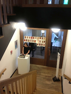 Claire Potter live writing at art gallery