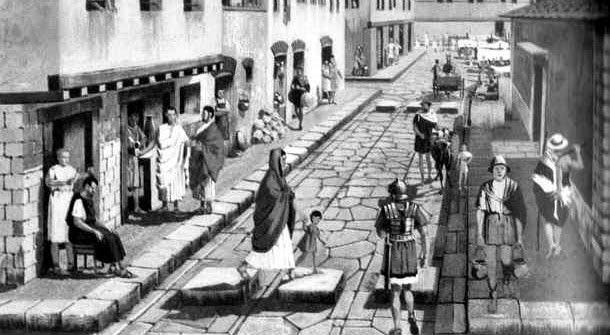 Calle con ciudadanos de la antigua Roma