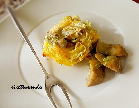 Nidi di tagliatelle all'uovo con carciofi ricetta di pasta a forno con verdure