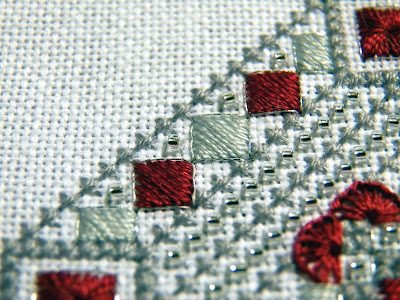 Close-up of border motif - satin-stitched diamonds