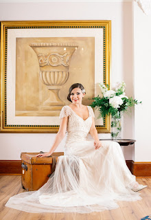 girl models a vintage dress and accessories and hair for a wedding magazine