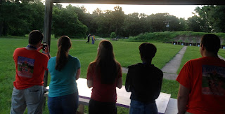 Students watch a demonstration at the Police Firing Range.