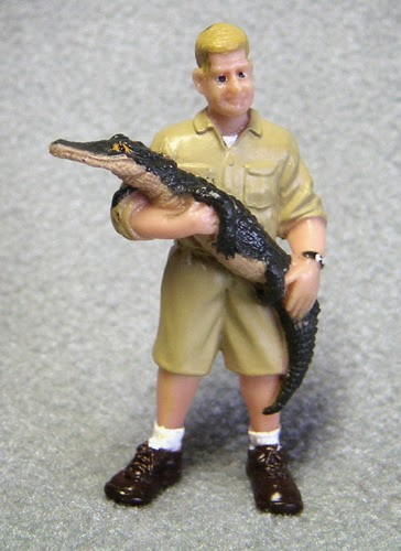 Alligator or Crocodile Handler Small Plastic Figurine (Man holding crocodile, looks like Steve Irwin)