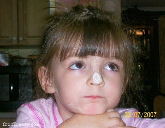 Flour on Katarina's nose and face