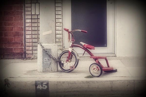 Morgan's Milieu | Do Your Children Know the Green Cross Code?: bent Tricycle chained to a lampost.