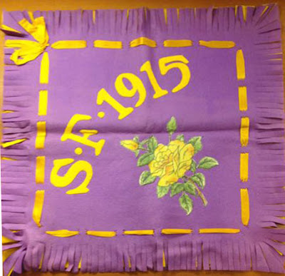 """photo of purple and yellow """"S.F. 1915"""" banner"""