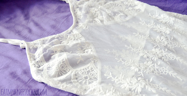 Close-up details on the sheer spaghetti-strap white lace maxi dress from SheIn, a perfect boho layering slip.