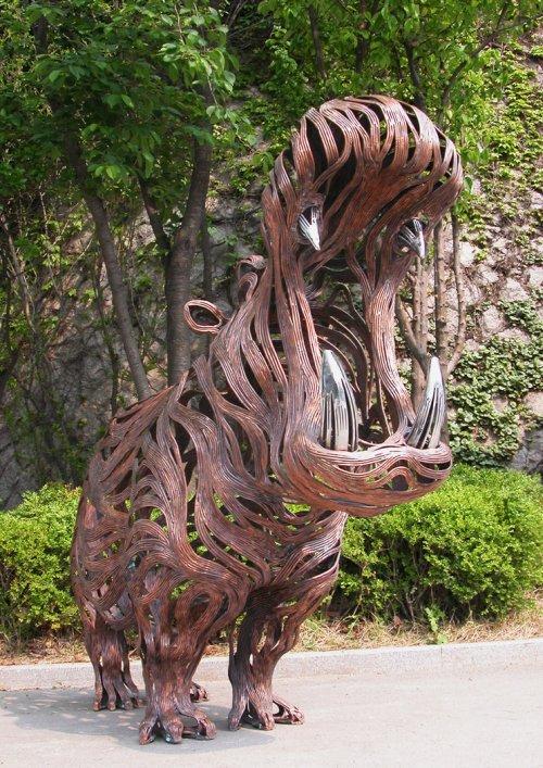 Kang Sung Hoon  esculturas de animais ao vento com tiras de metal Hipopótamo