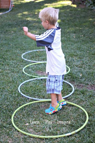 Gross motor activity hula hoop games learn play imagine for Gross motor toddler activities