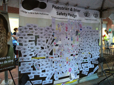 The crosswalk covered in pedestrian and driver safety pledges.