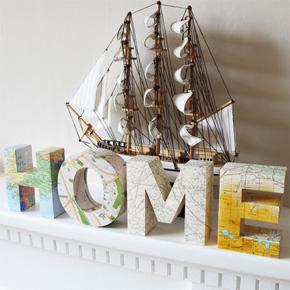 Palavra HOME forrada com estampa de mapa