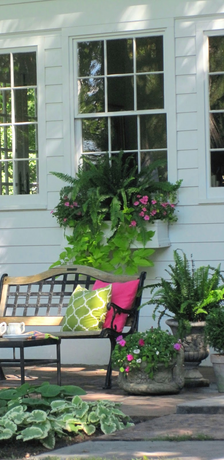 simple details create overflowing window boxes and