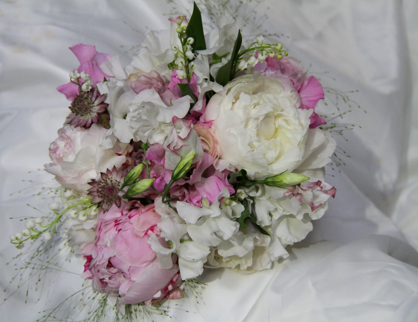 peonies lily of the valley and sweet peas surrounded by a haze of