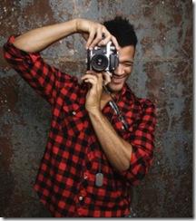 pessoa com máquina fotográfica
