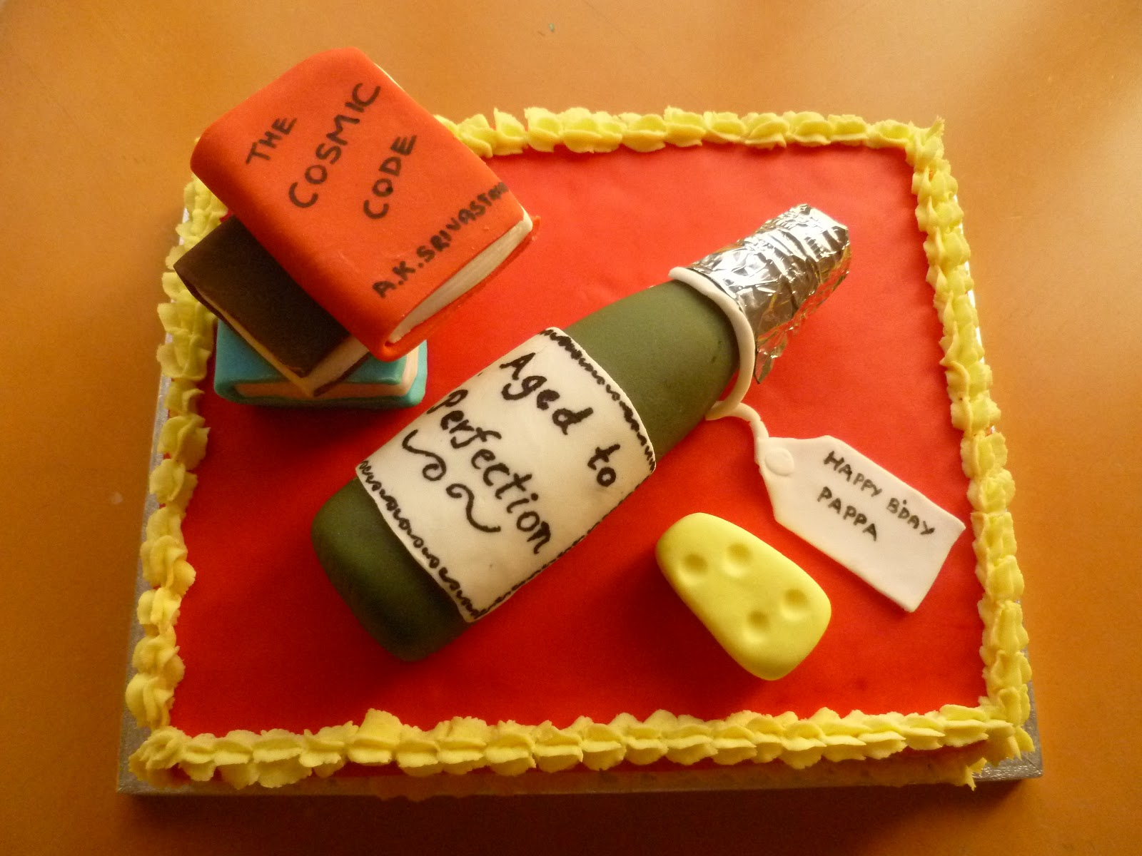 RUCHI Birthday Cake with Edible Handmade Wine Bottle Books and