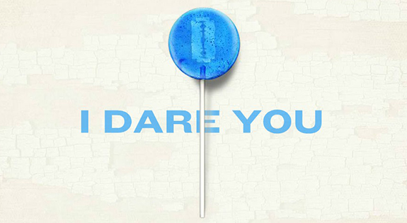 "blue lollipop with a razor inside the candy over the text ""I dare you"""
