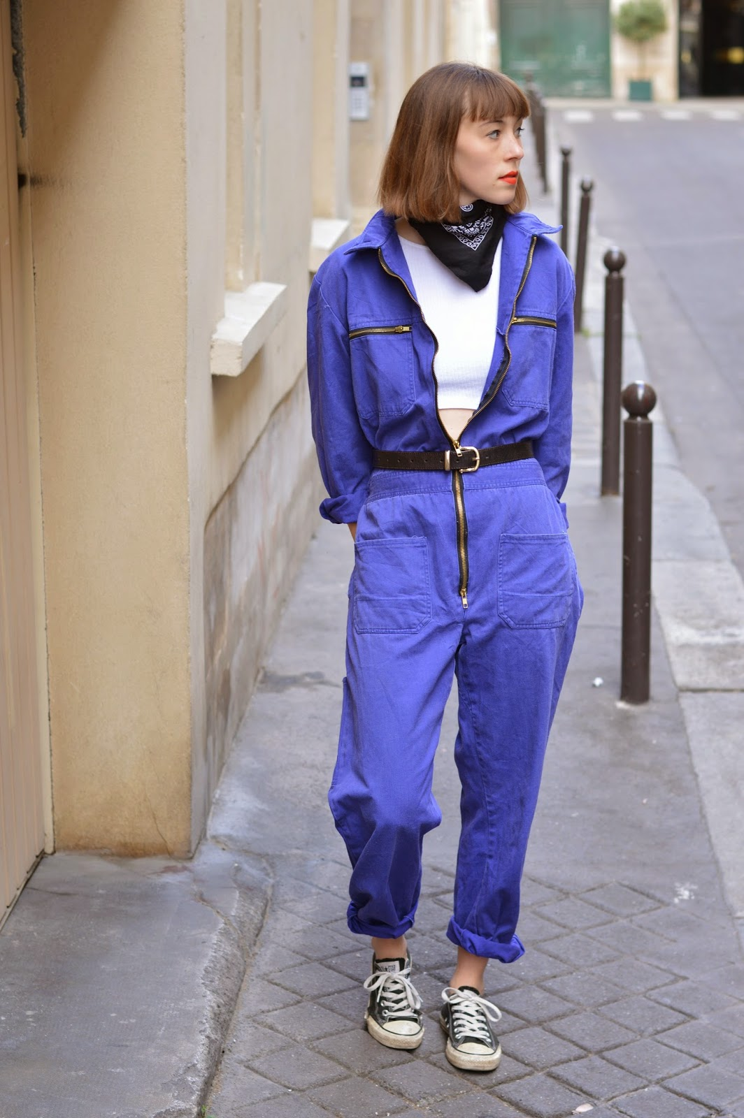 Blue boiler suit worn unzipped open with white topshop crop top, belt and bandana