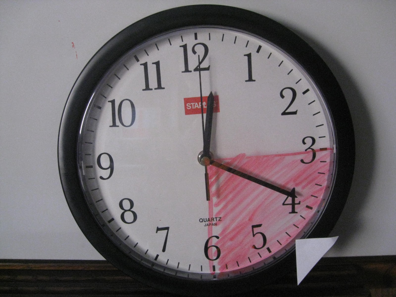 This staples clock does not have a glass face a glass face d clock
