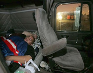 a-trucker-taking-rest-in-his-truck