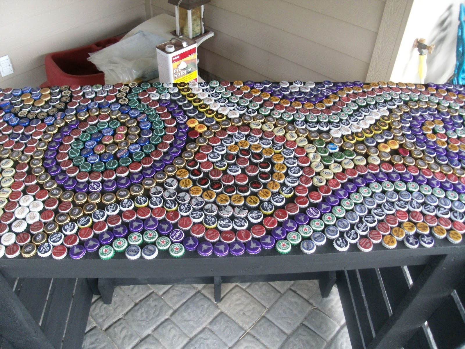My art projects bottle cap countertop for Bottle top art projects