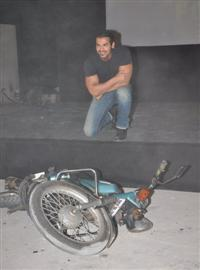 John Abraham lifts bike to promote 'Force' showing Muscular Body