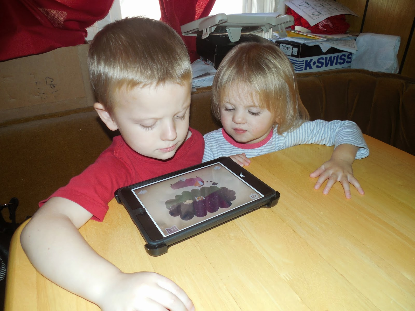 They Watch And Play The Ipad Together All The Time