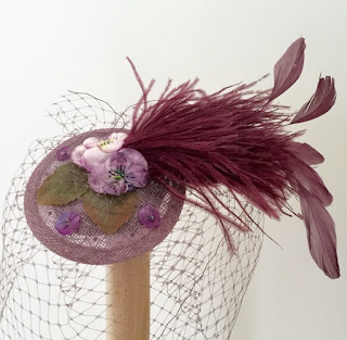 https://folksy.com/items/6688095-Lilac-vintage-flowers-feather-fascinator-weddings-veil-