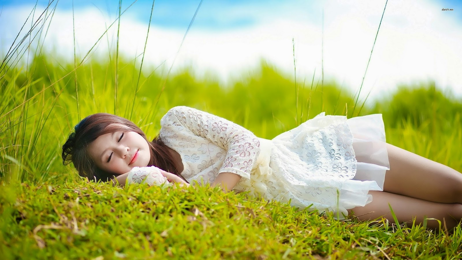 Cute Girl in The Grass Wallpaper