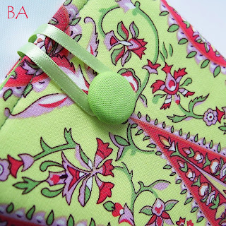 Quality fabric Kindle cover, handmade for women in a contemporary pink and green floral fabric.