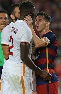 Barcelona's Lionel Messi goes face to face with Roma's Mapou during their frienly match at Nou Camp, Barcelona, August 05 2015