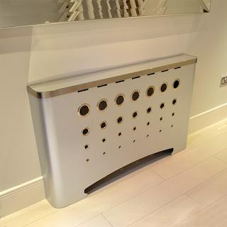 Modern custom made radiator covers in galvanised metal