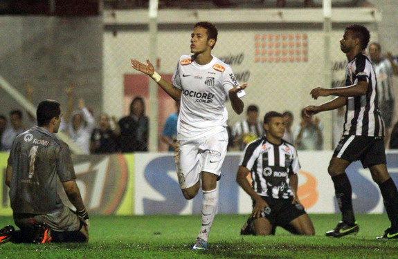 Santos star Neymar celebrates after scoring one of his four goals against União Barbarense
