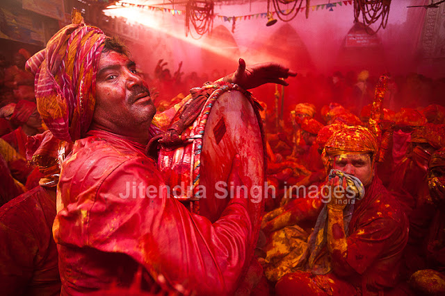 Here comes the very first and rocking PHOTO JOURNEY by Jitendra Singh, one of the great photographers. Photographers at PHOTO JOURNEY welcome Mr. Jitendra Singh and congratulate him for his first PHOTO JOURNEY with great colors. Let's check out these interesting Holi photographs from Barsana, Nandgaon, Goverdhan, Vrindavan and Mathura...The Hindu festival of Holi which is also called as the Festival of Colors celebrated with much enthusiasm in the month of Phalgun, which usually corresponds to the month of March. It marks the arrival of spring and the bright colors represent energy, life, and joy. The festival of colors is also very special for Photographers like Jitendra Singh, who visited one of the important places in India where Holi is celebrated in very special ways. This Photo Journey shares photographs from various parts of Uttar Pradesh.In Mathura, the birthplace of Lord Krishna and in Vrindavan this day is celebrated with special puja and the traditional custom of worshiping Lord Krishna, here the festival lasts for sixteen days. All over the Braj region and its nearby places like Hathras, Aligarh, Agra the Holi is celebrated in more or less same way as in Mathura, Vrindavan and Barsana. This great festival is associated with the immortal love of Lord Krishna and Radha and hence, Holi is spread over 16 days in Nandgaon, Barsana, Goverdhan, Vrindavan as well as Mathura - the cities with which Lord Krishna shared a deep affiliation. Apart from the usual fun with colored powder and water, Holi is marked by vibrant processions which are accompanied by folk songs, dances and a general sense of abandoned vitality. These photographs share the mood of Holi with great enthusiasm, music, dance and lot of excitement in various forms. Barsana is the place to be at the time of Holi. Here the famous Lath mar Holi is played in the sprawling compound of the Radha Rani temple. Thousands gather to witness the Lath Mar holi when women beat up men with sticks as those on the sidelines become hysterical, sing Holi Songs and shout Sri Radhey or Sri Krishna. The Holi songs of Braj mandal are sung in pure Braj BhashaHoli is known by the name of 'Dol Jatra', 'Dol Purnima' or the 'Swing Festival'. The festival is celebrated in a dignified manner by placing the icons of Krishna and Radha on a picturesquely decorated palanquin which is then taken round the main streets of the city or the village. The devotees take turns to swing them while women dance around the swing and sing devotional songs. During these activities, the men keep spraying colored water and colored powder, abir, at them.The Holi celebration has its celebration origins in Gujarat, particularly with dance, food, music, and colored powder to offer a spring parallel of Navratri, Gujarat's Hindu festival celebrated in the fall. Falling on the full moon day in the month of Phalguna, Holi is a major Hindu festival and marks the agricultural season of the Rabi cropOn Dol Purnima day in the early morning, the students dress up in saffron-colored or pure white clothes and wear garlands of fragrant flowers. They sing and dance to the accompaniment of musical instruments like ektara, dubri, veena, etc. Holi played at Barsana is unique in the sense that here women chase men away with sticks. Males also sing provocative songs in a bid to invite the attention of women. Women then go on the offensive and use long staves called lathis to beat men folk who protect themselves with shieldsIn Maharashtra, Holi is mainly associated with the burning of Holika. Holi Paurnima is also celebrated as Shimga. A week before the festival, youngsters go around the community, collecting firewood and money. On the day of Holi, the firewood is arranged in a huge pile at a clearing in the locality.