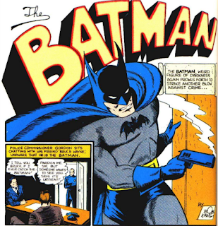This is a picture from Detective Comics #35 showing Batman holing a smoking pistol.