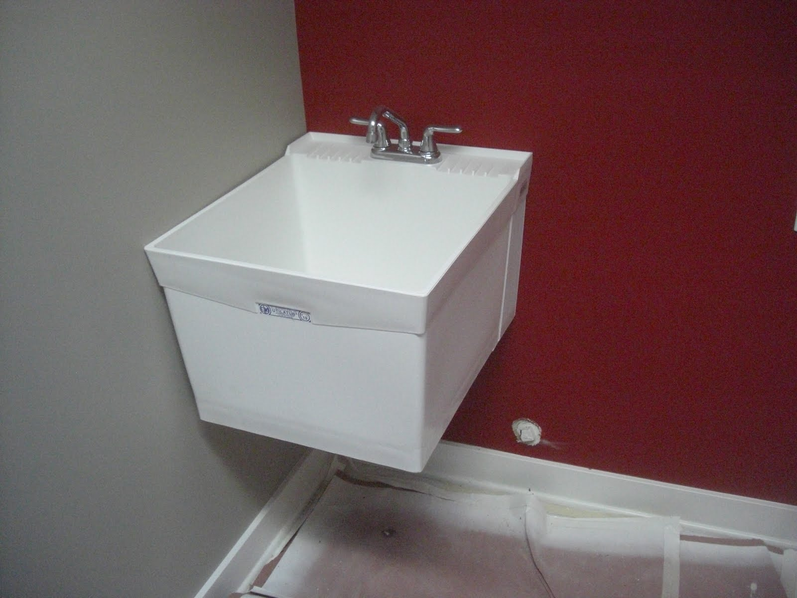 Here is the laundry washtub. It is wall mounted.