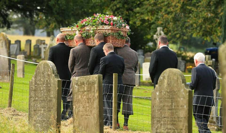 The coffin of Deborah, the Dowager Duchess of Devonshire is carried from St Peter's Church following her funeral service, on the Chatsworth estate, England, 02.10.2014. The last of the famous Mitford sisters, the Dowager Duchess of Devonshire, died at the age of 94.