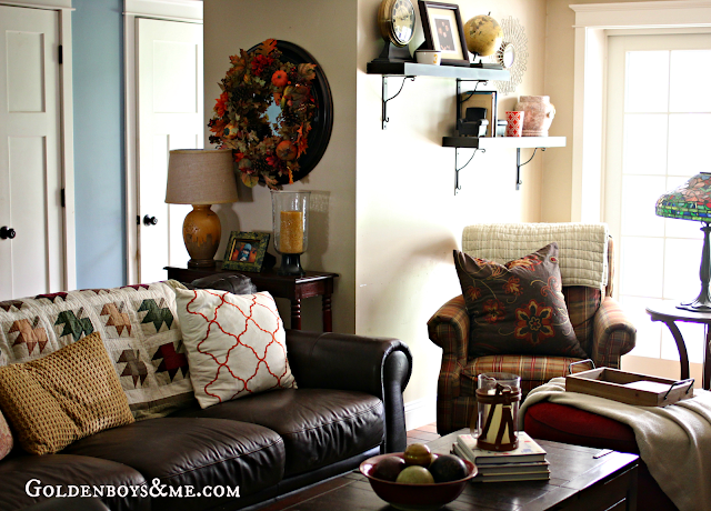 Fall wreath and quilt, plaid chairs, part of Fall Home Tour via www.goldenboysandme.com