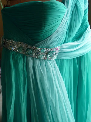 A Grecian style gown in aqua blue with light blue overlay