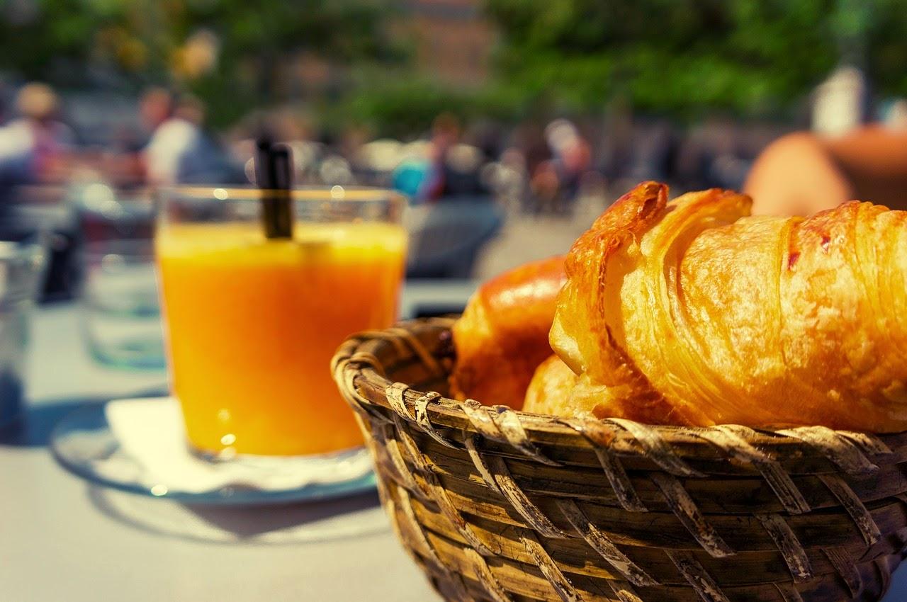 Breakfast outdoor cafe croissant orange juice