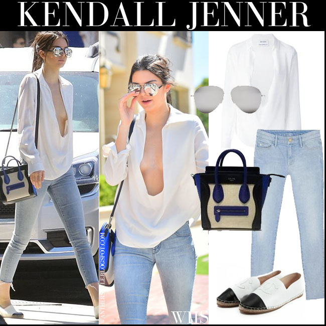 Kendall Jenner in white plunging blouse, skinny jeans and mirrored silver sunglasses what she wore july 14