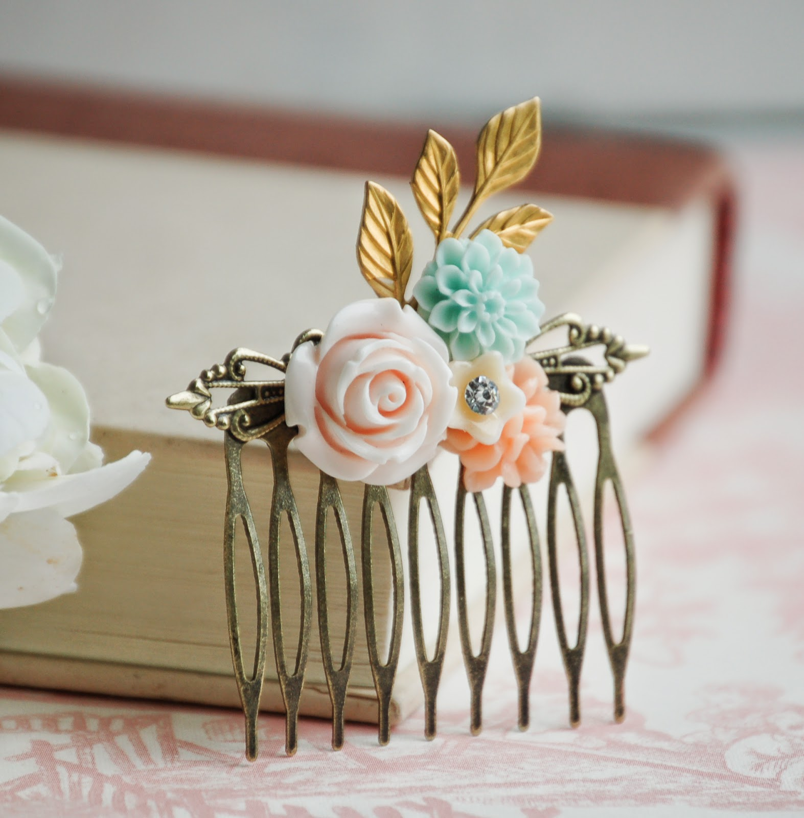 https://www.etsy.com/listing/190818440/rose-flower-hair-comb-pink-peach-aqua?ref=shop_home_active_2&ga_search_query=flower%2Bhair%2Bcombs